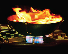 cooking with wok and flames